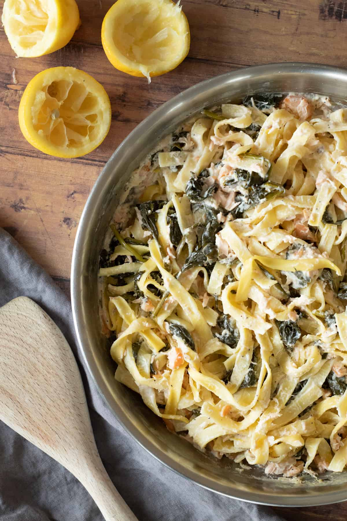 salmon spinach pasta in a pan