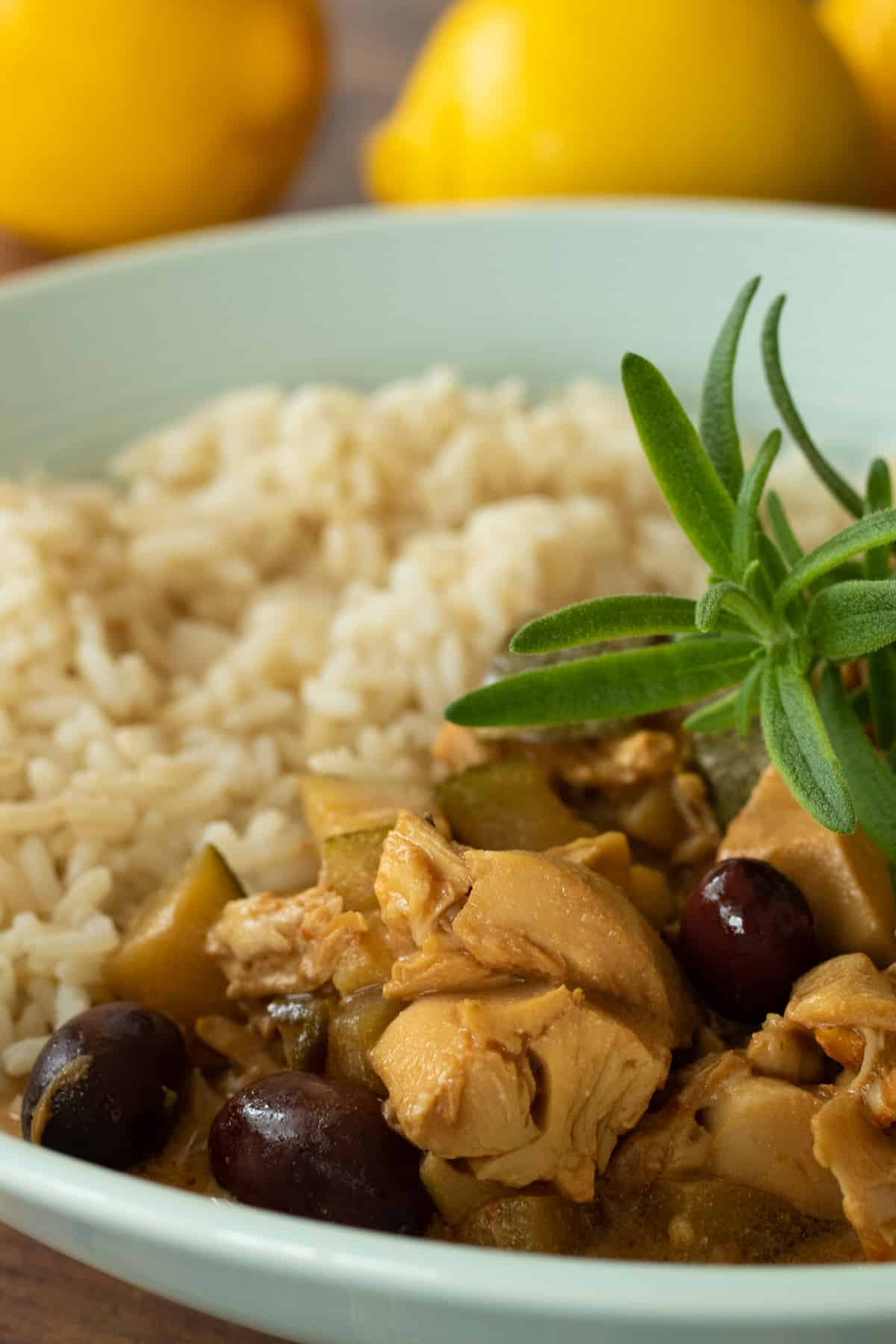 spanish chicken stew and rice topped with rosemary