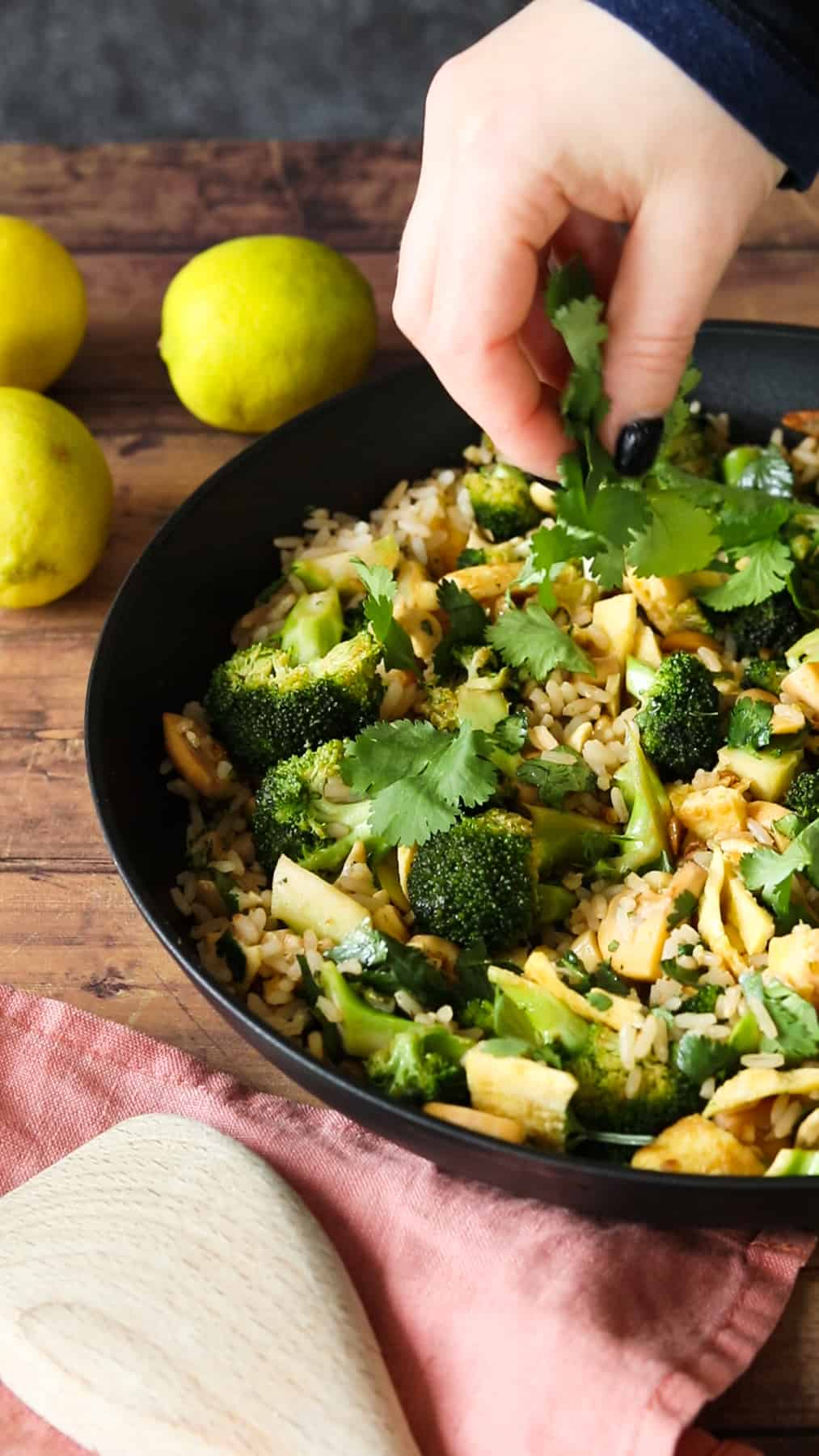 thai curry fried rice being topped with fresh cilantro