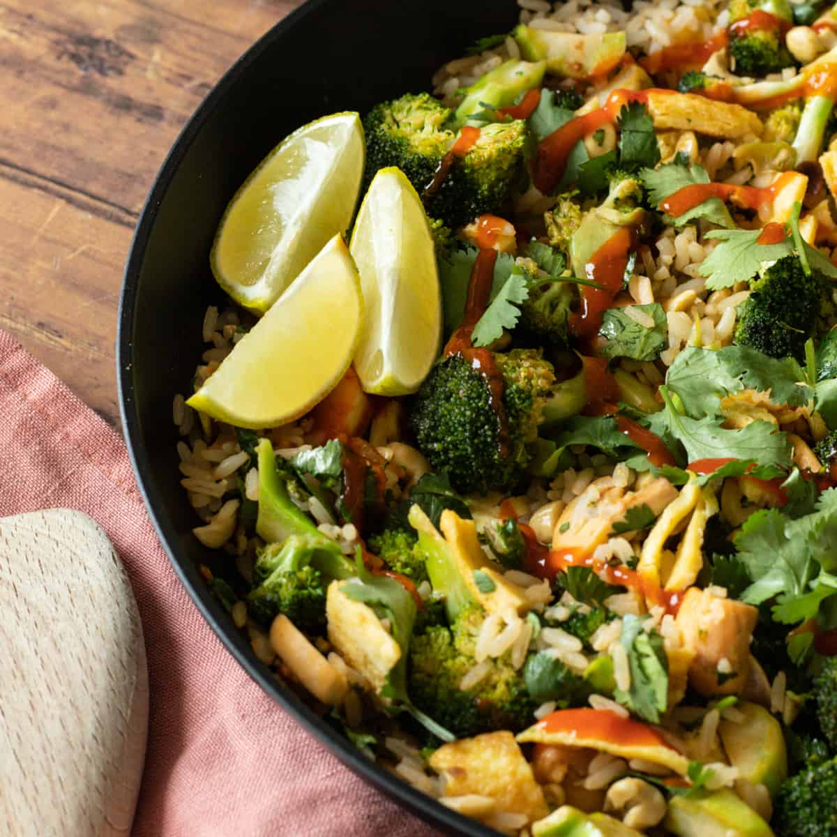 thai curry fried rice wit with lime wedges