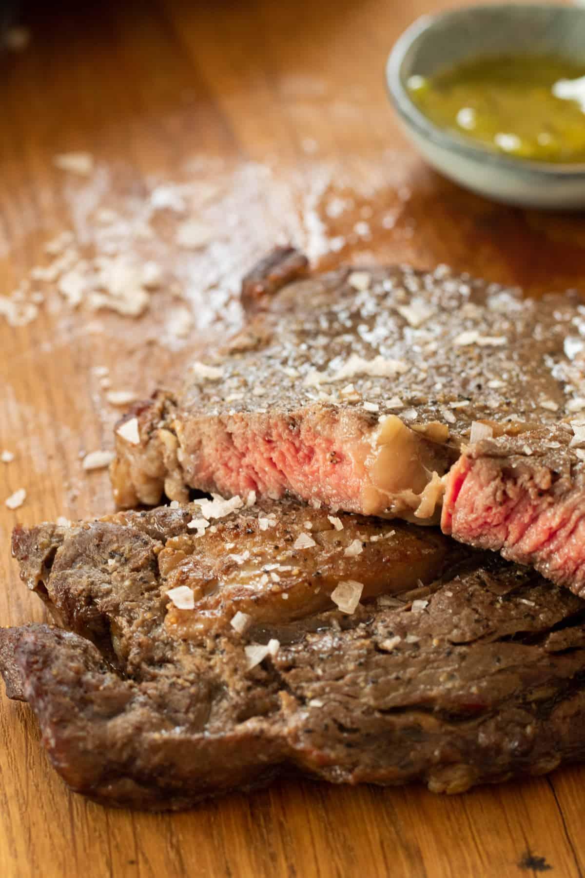 sliced rib eye steak topped with salt
