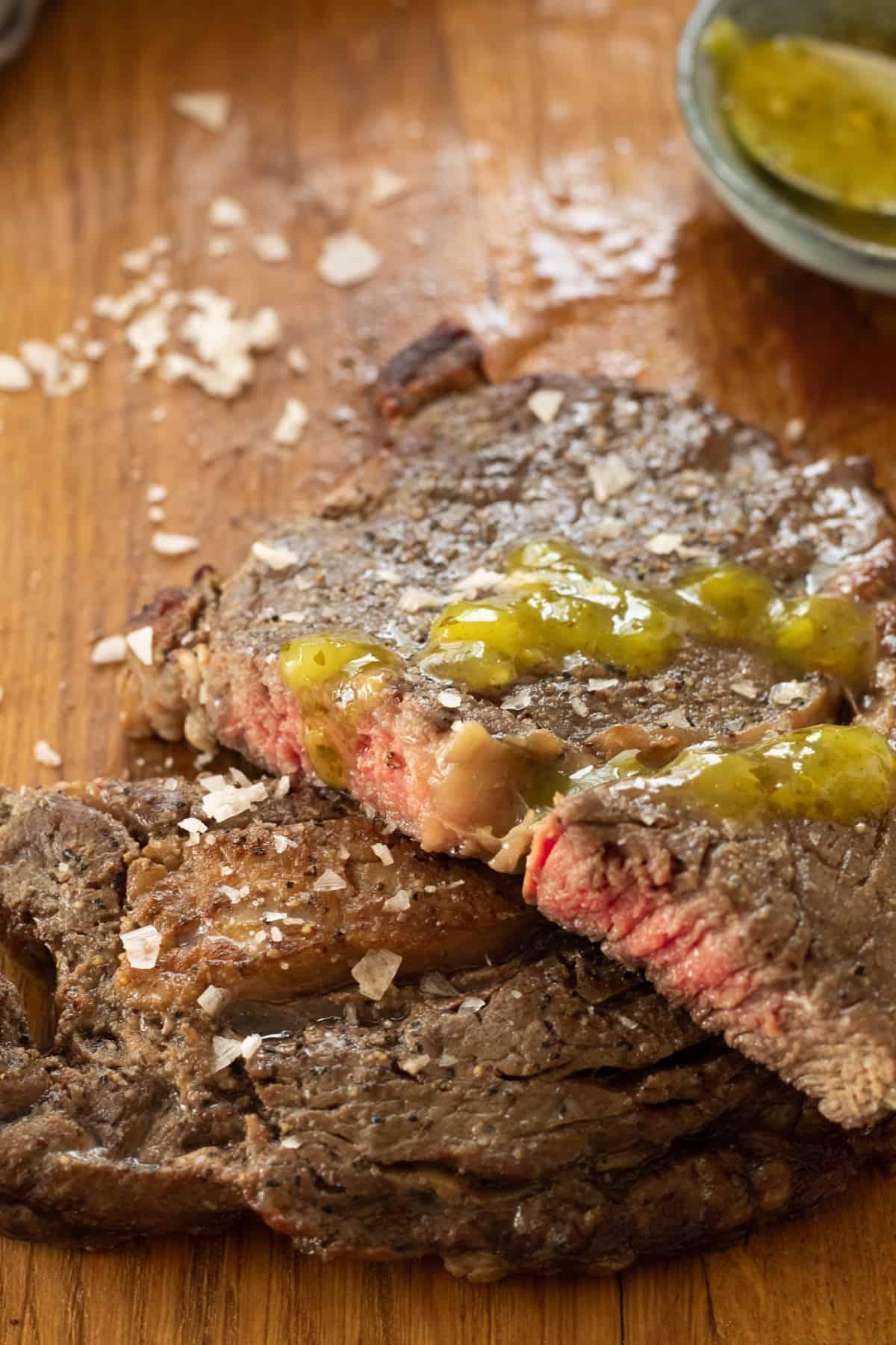 rib eye steak topped with green salsa