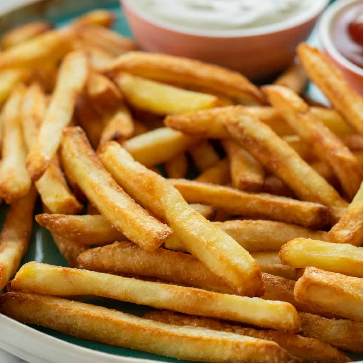 close up of french fries on a plate