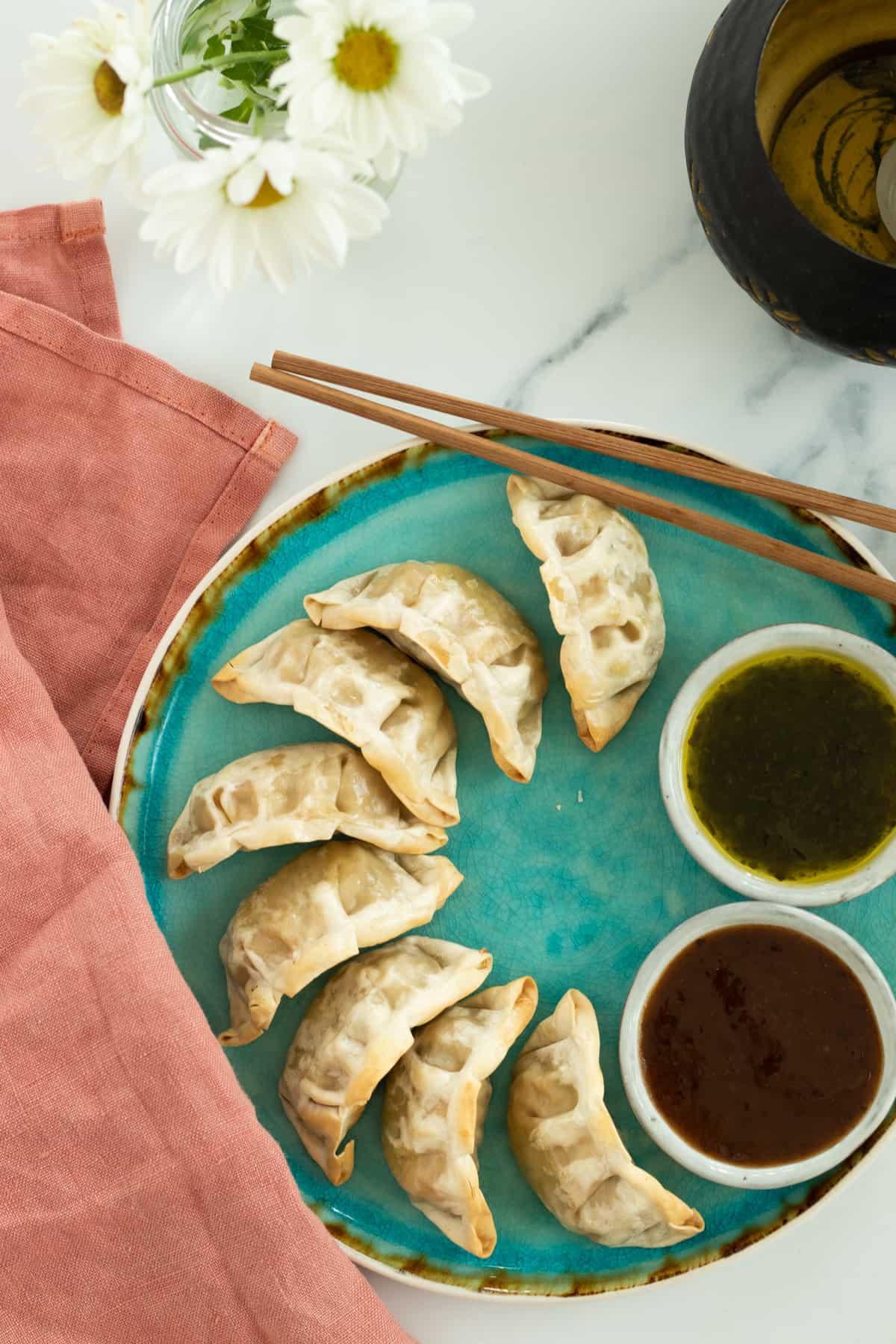 dumplings on a blue plate