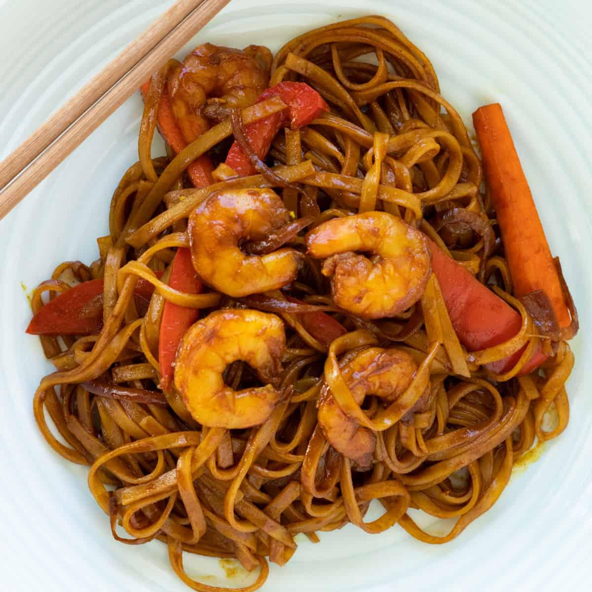 shrimp mei fun on a plate with chopsticks