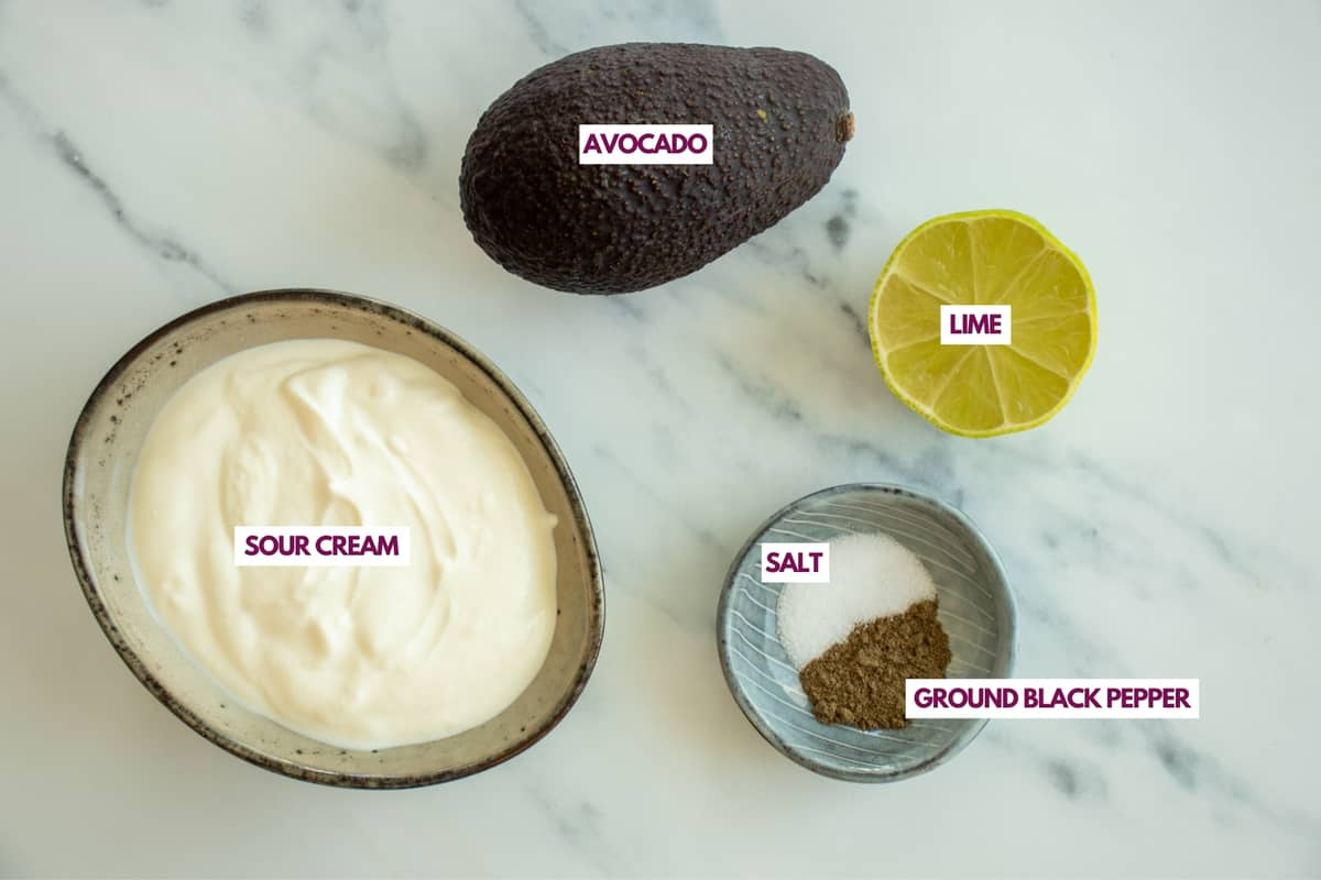 ingrredients for sour cream sauce with avocado and lime