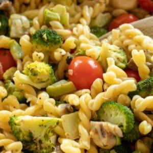 creamy broccoli pasta in a skillet